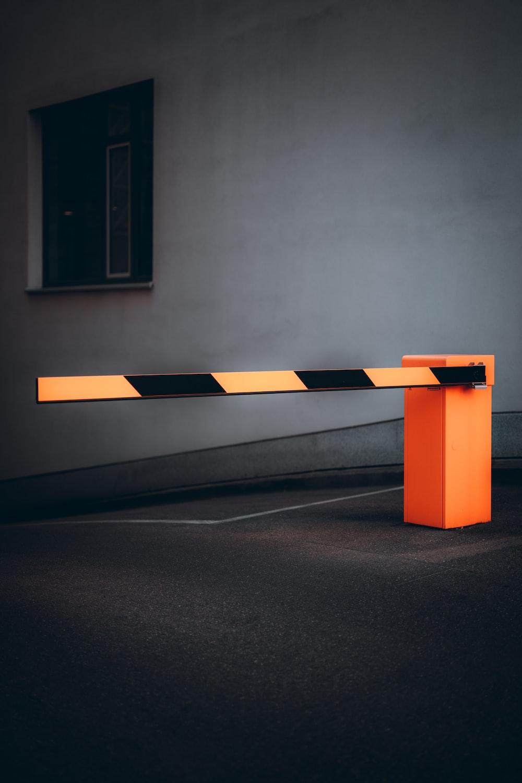 orange and white wooden bench
