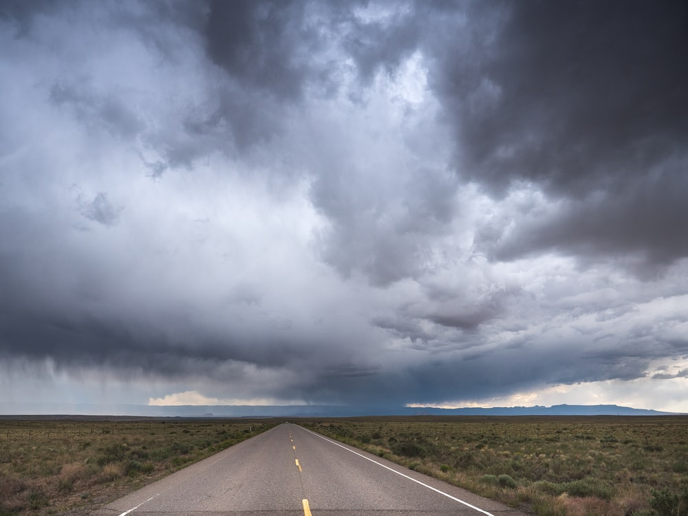 gray asphalt road under gray clouds