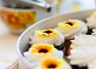 white and yellow cupcakes on white ceramic plate