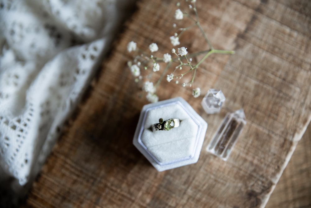 white flower on clear glass container