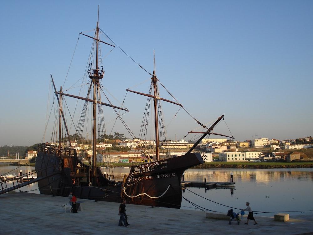 black ship on water during daytime