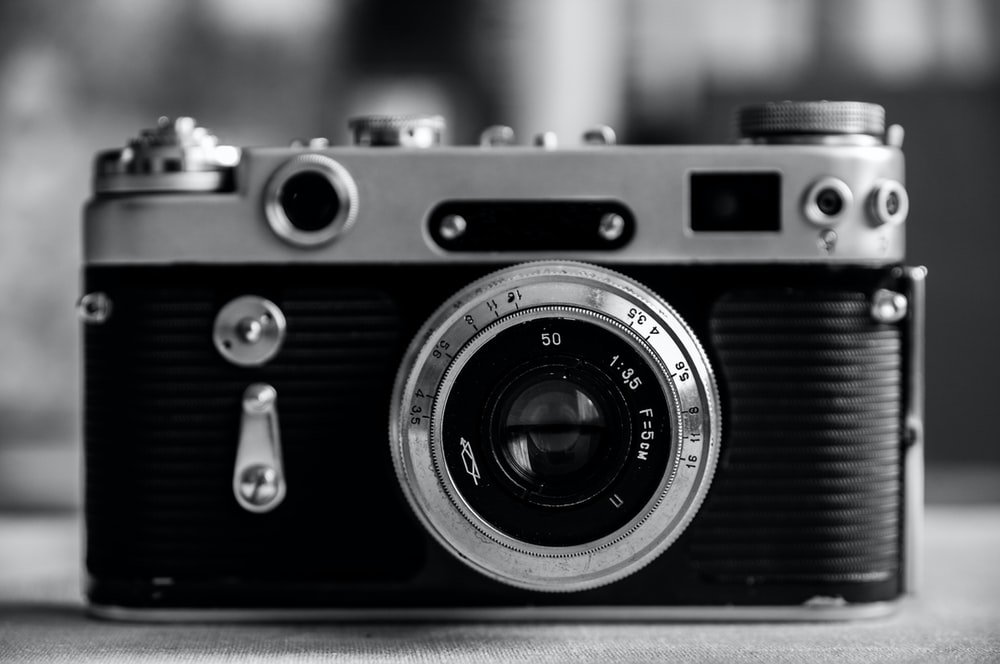 black and silver camera on table