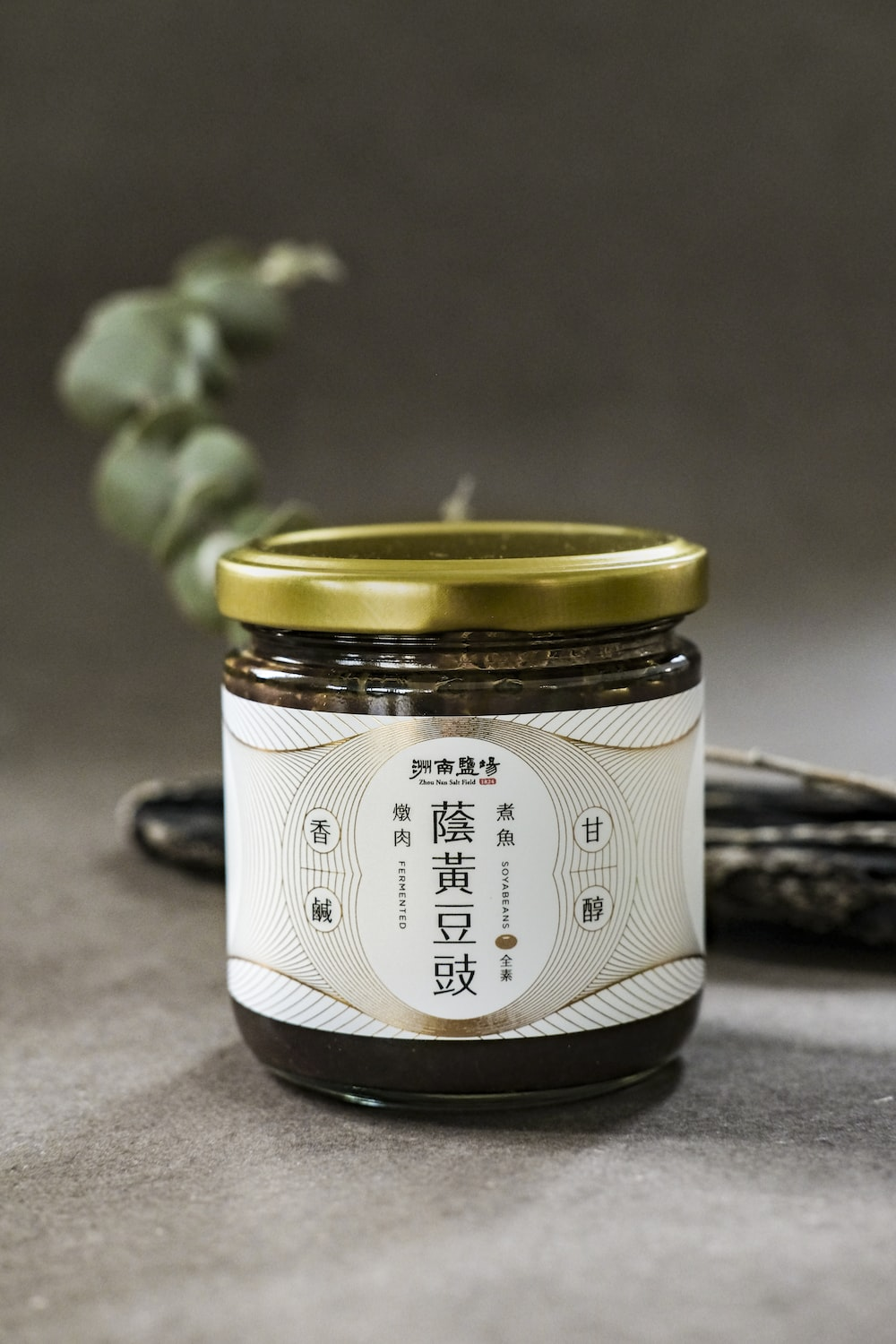 white and black labeled jar