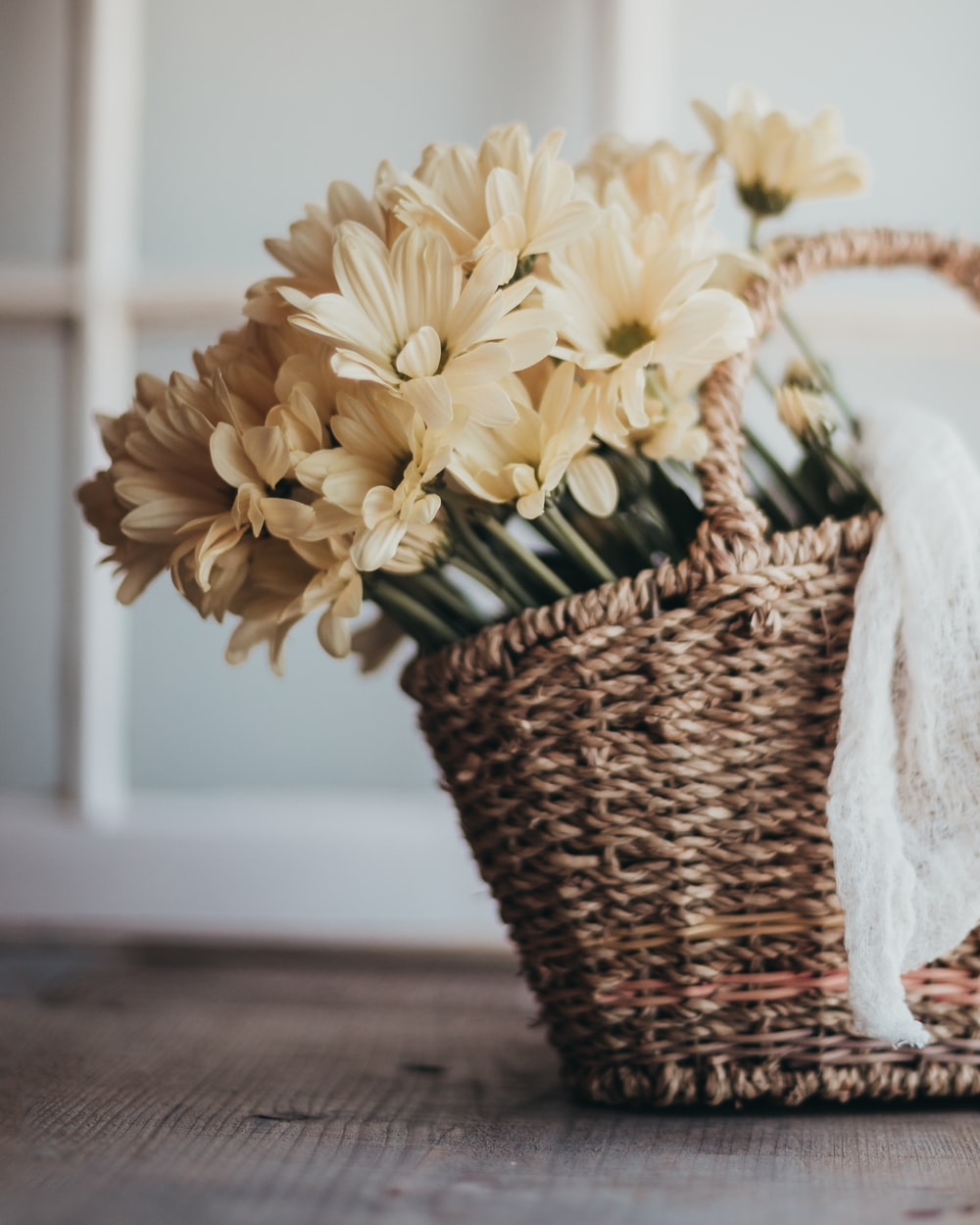yellow flowers in brown woven basket