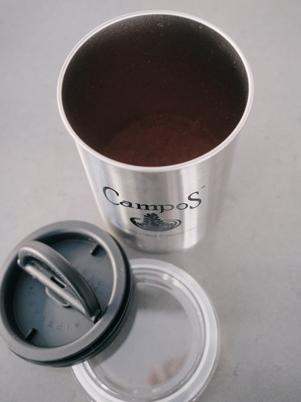 silver and white disposable cup