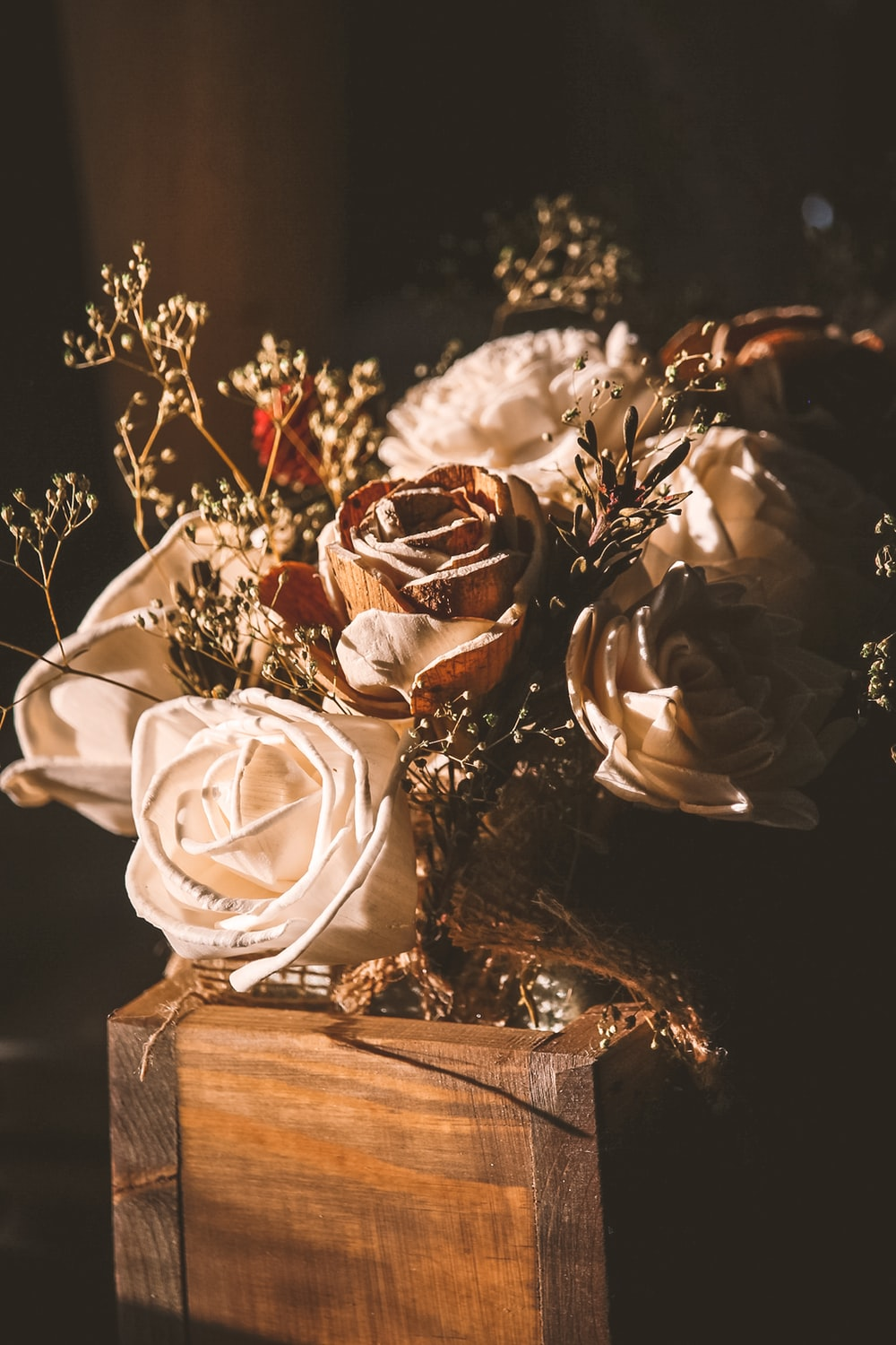 white rose bouquet on brown wooden table