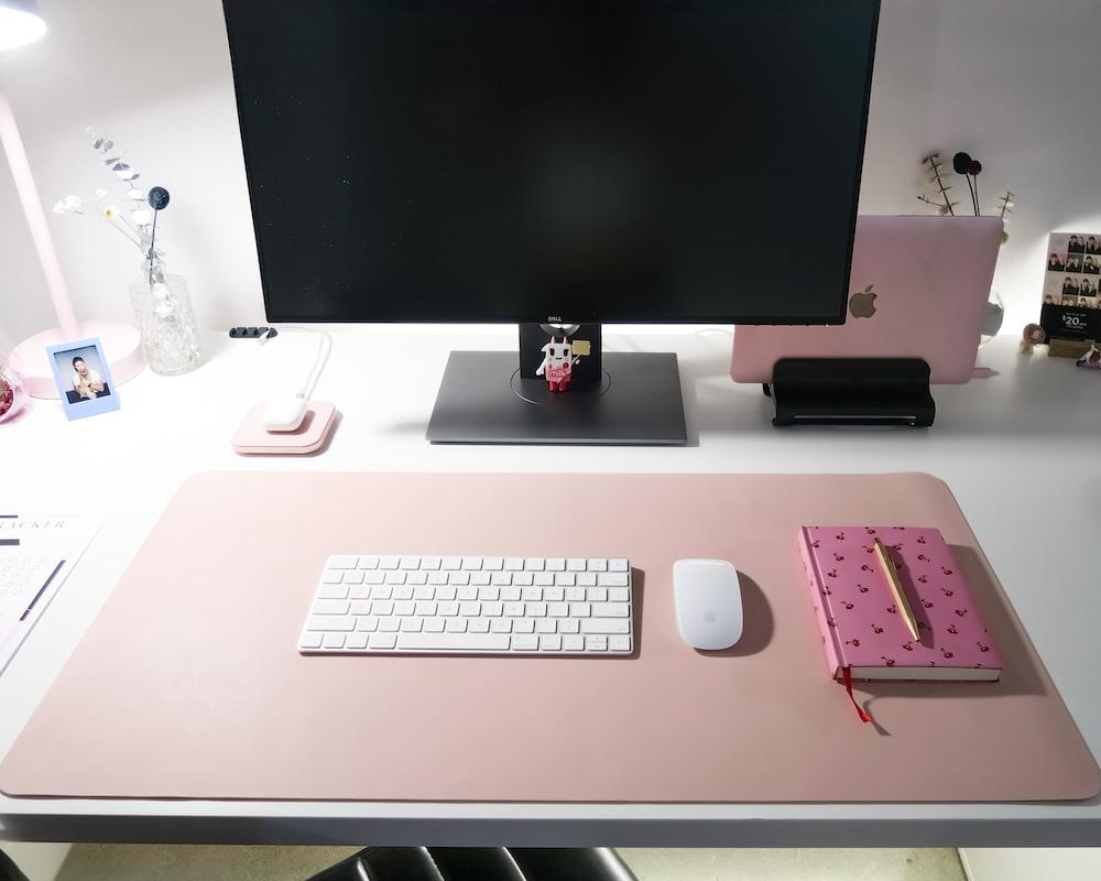 silver imac on white desk