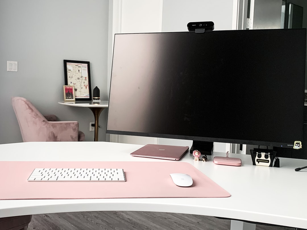Clean all pink home office setup