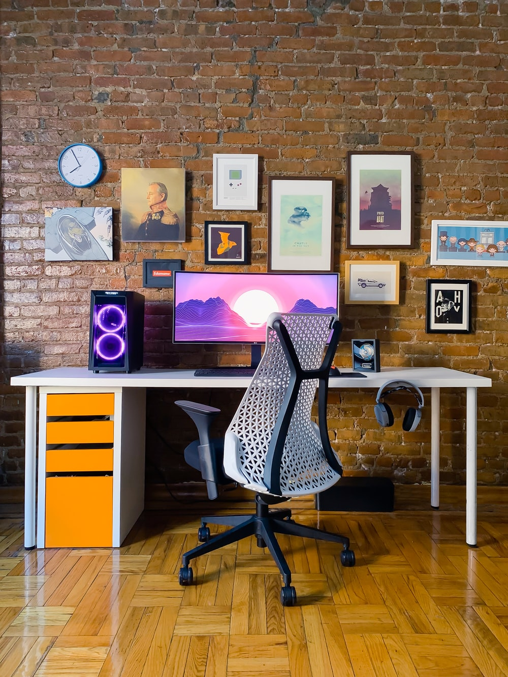 black rolling chair near white wooden desk
