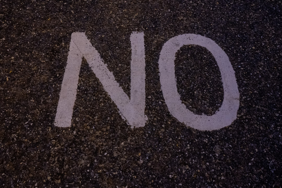 Part of the No Cycling sign on the beach front at Southbourne Beach.