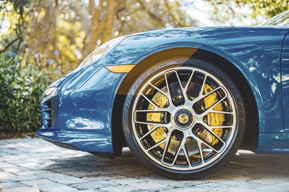 blue car with yellow wheel