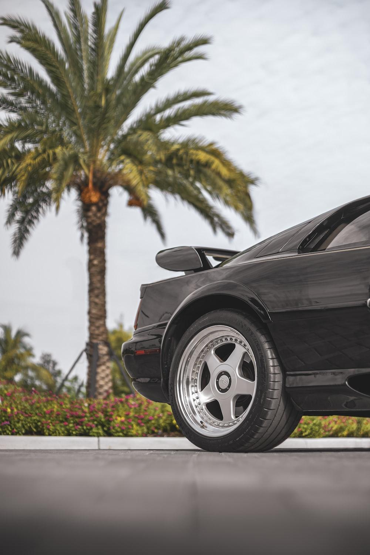 black porsche 911 parked on parking lot during daytime