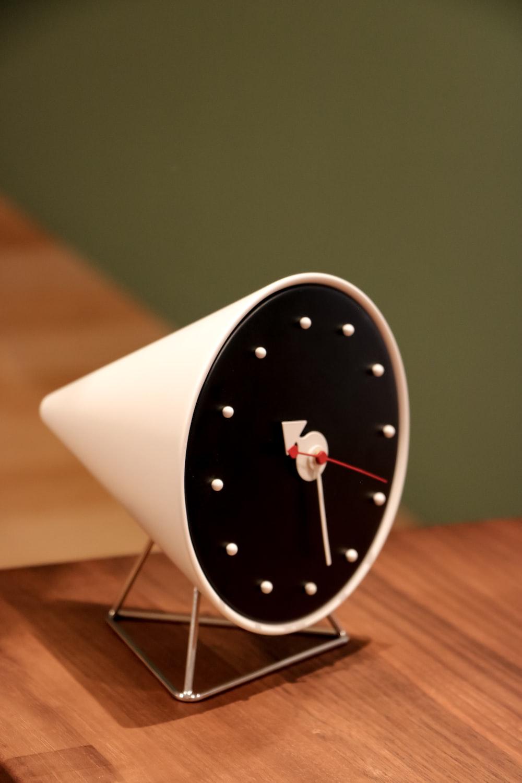 white and black round analog wall clock