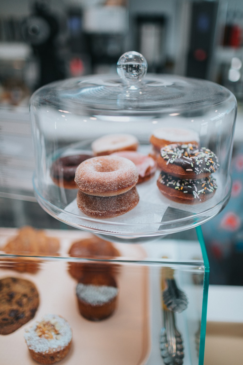 brown and white donuts on clear glass tray