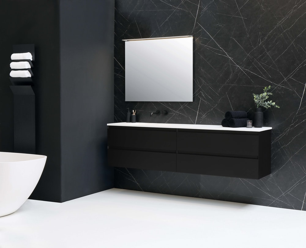 black flat screen tv mounted on gray wall