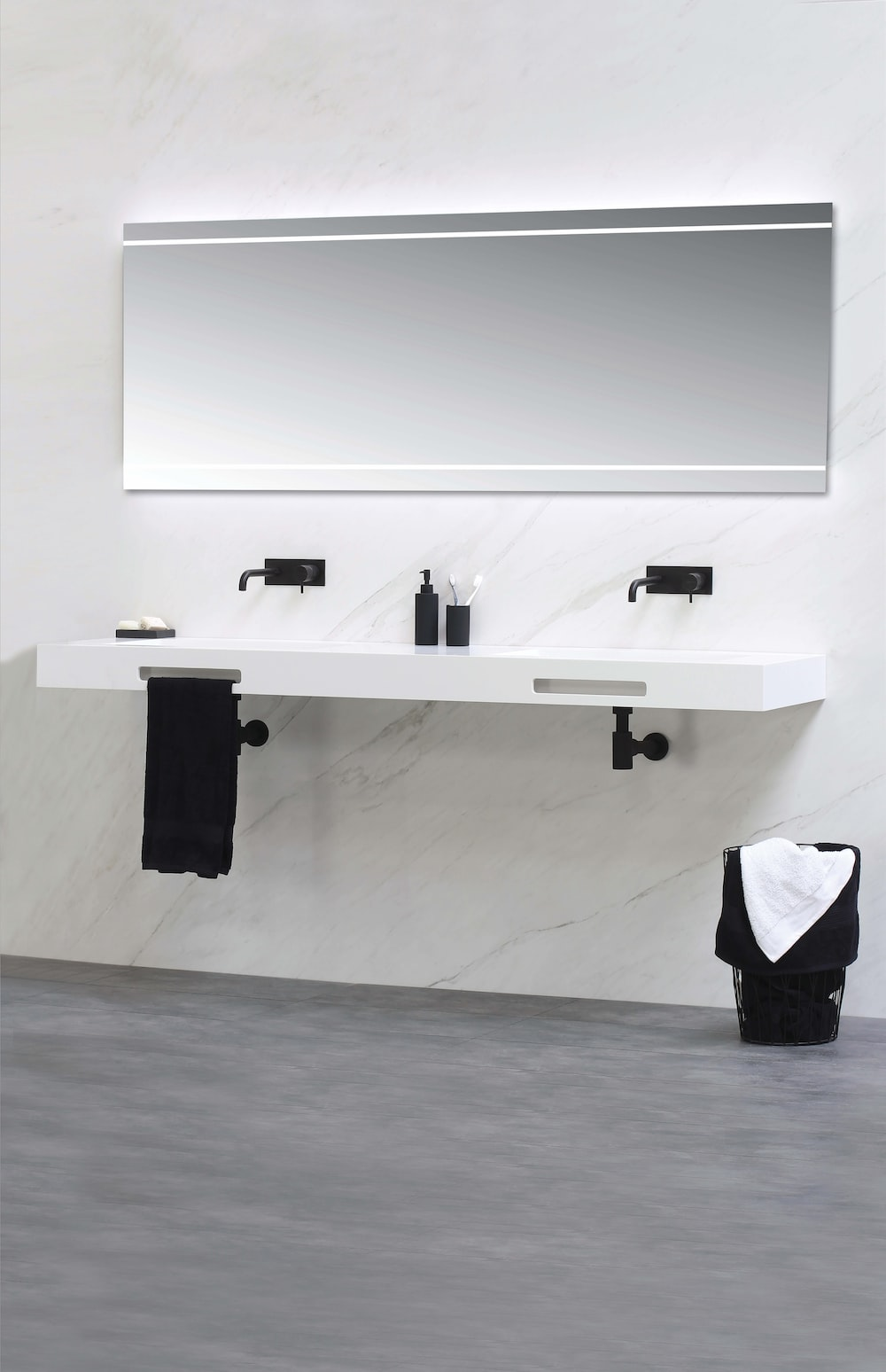 white wall mounted board with black bag