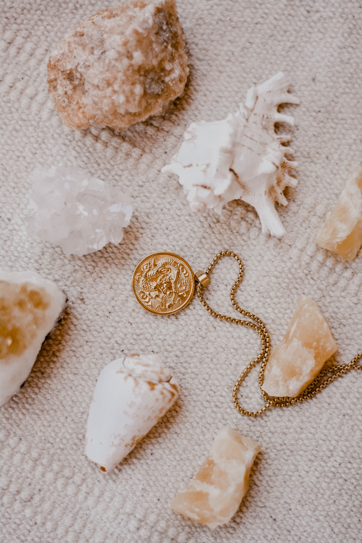 gold round coins on white textile