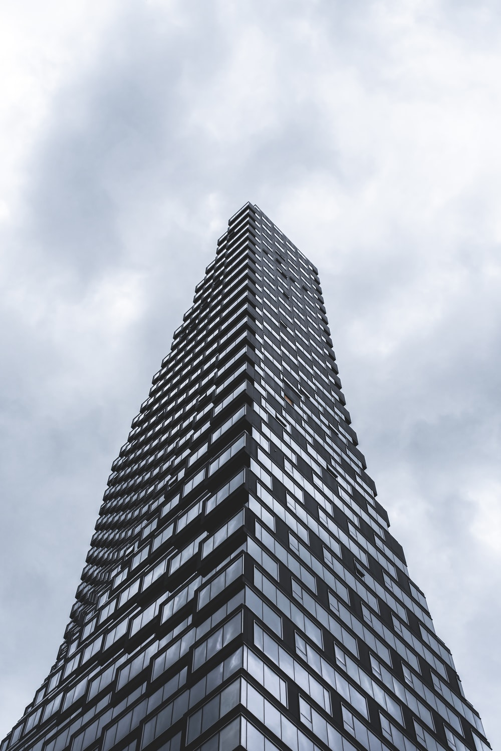 gray concrete building under cloudy sky during daytime