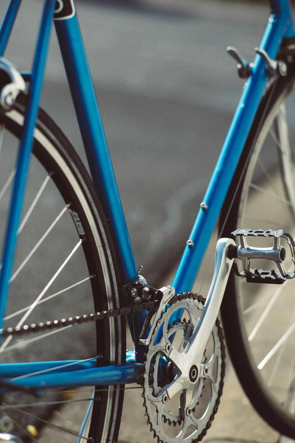 blue and black bicycle in close up photography