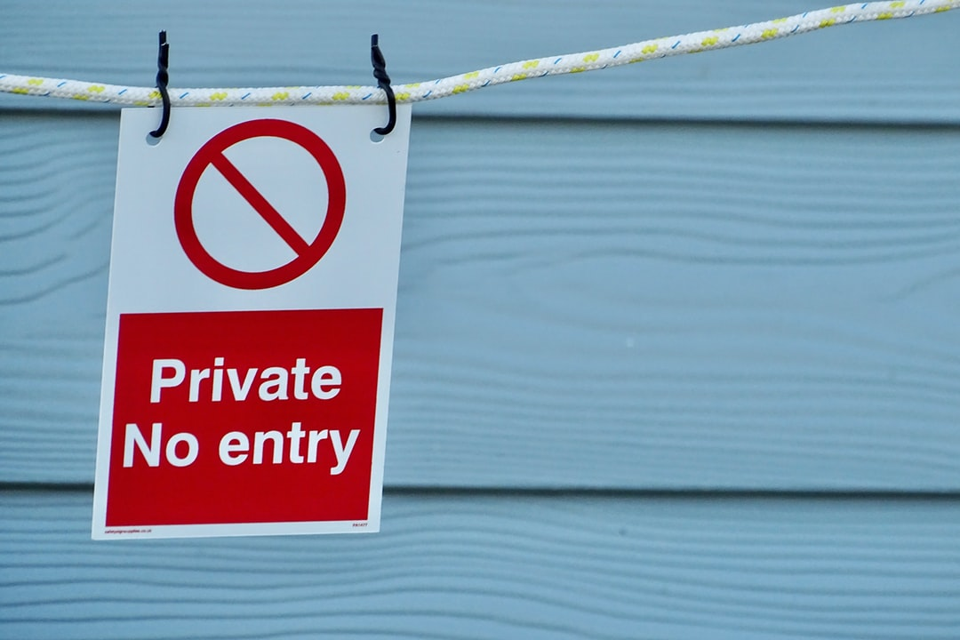 Making sure no one enters the Beach Hut along Mudeford Spit Christchurch Dorset. I like the contrasting colours and the notice definitely stands out.