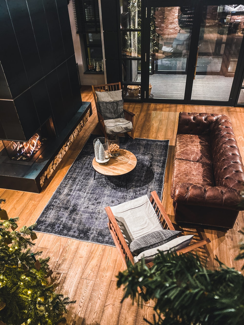 brown leather couch beside brown wooden table