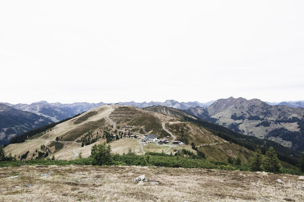 green grass field near mountains during daytime