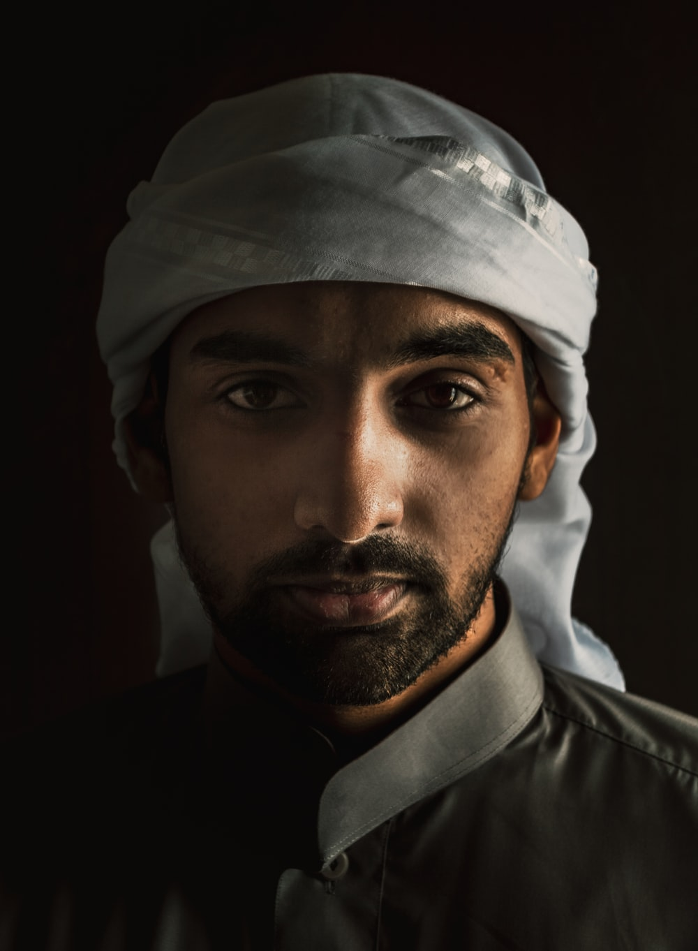 man in white turban and black suit