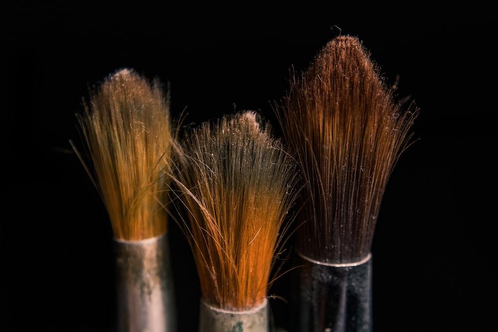 brown and black makeup brush