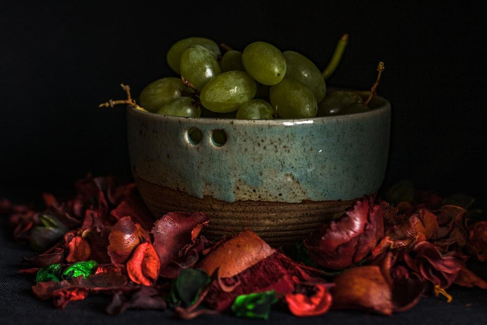 sliced green apple fruit on green ceramic bowl