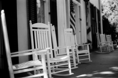 grayscale photo of wooden rocking chair alabama zoom background