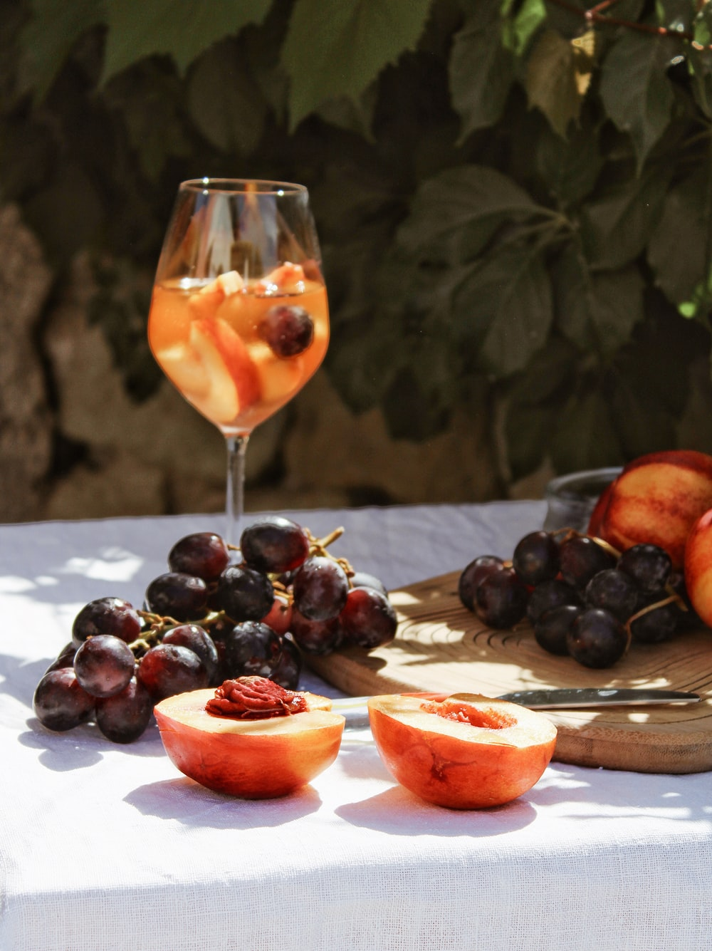 grapes and orange fruit on table