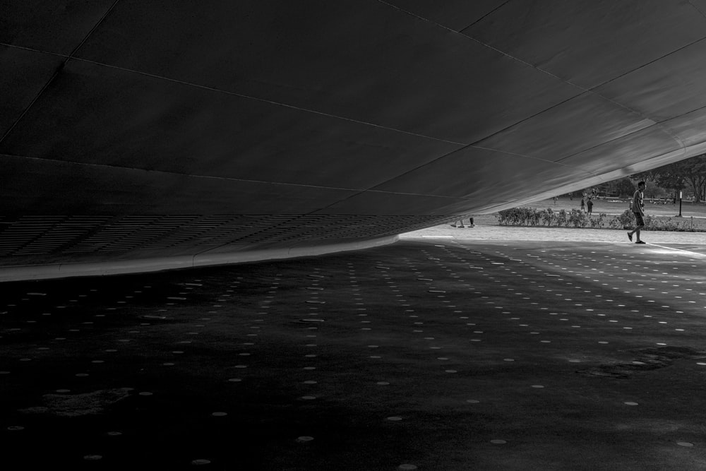 grayscale photo of road covered with snow