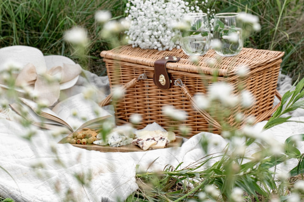 white flowers in brown woven basket
