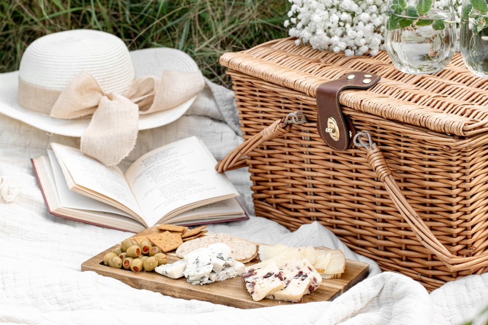 white and brown wicker basket with white textile