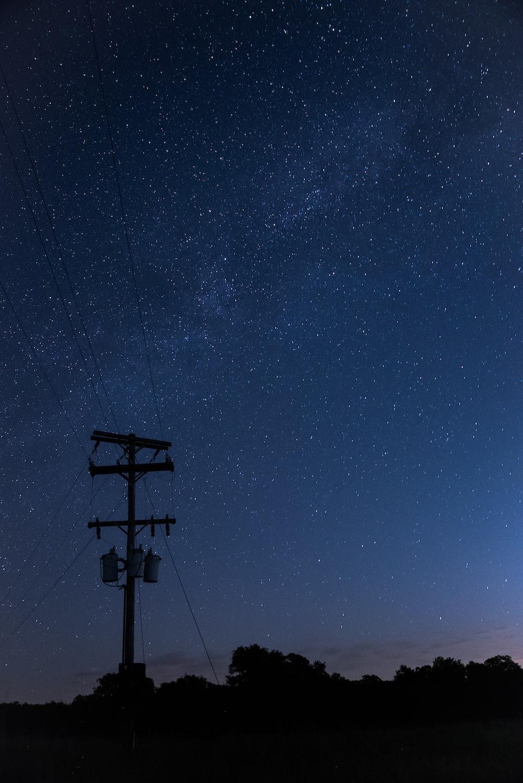 black street light under blue sky during night time