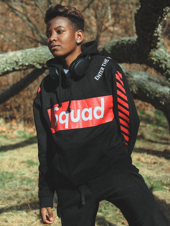 man in black and red adidas jacket wearing black headphones