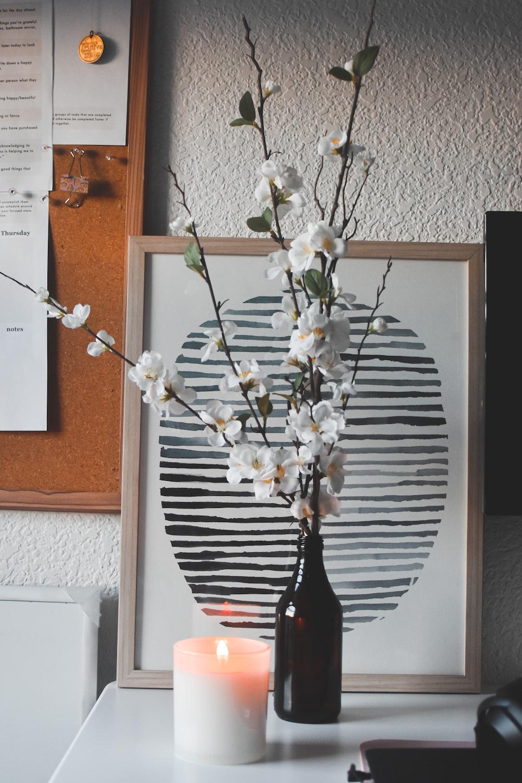 white flowers on black glass vase