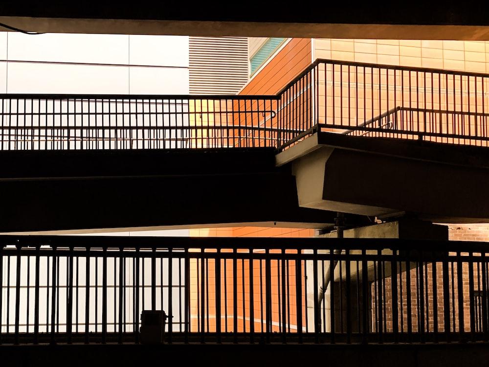 brown wooden staircase with black metal railings