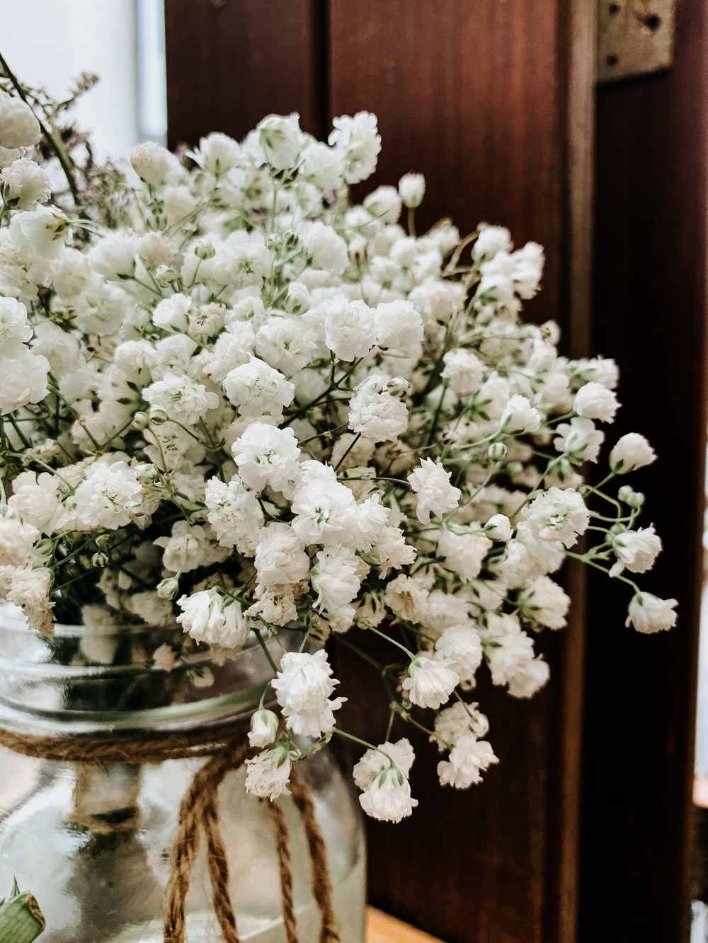 white flowers on clear glass vase