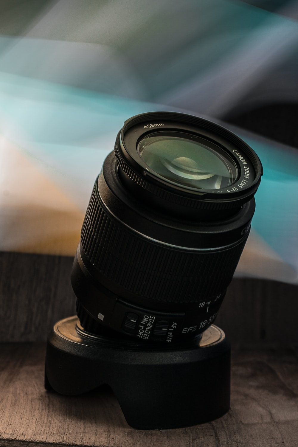 black camera lens on brown wooden table