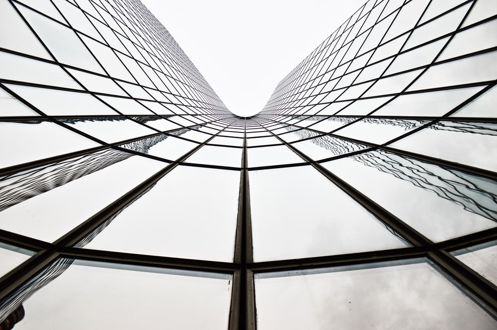 low angle photography of gray metal building