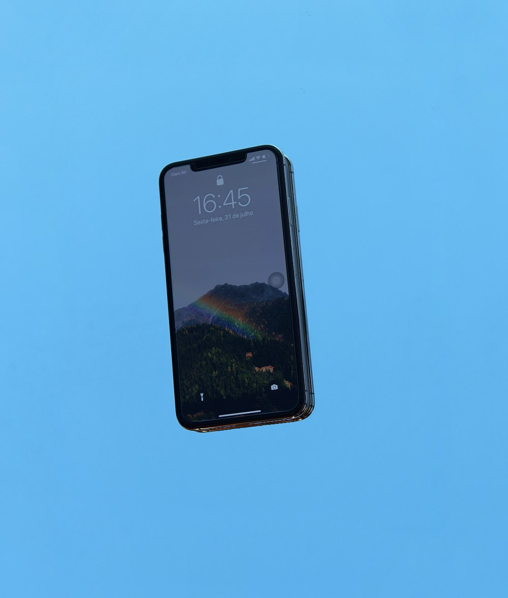 black iphone 4 on blue surface