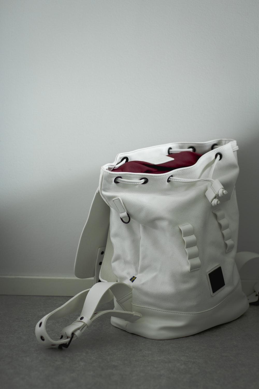 white and black nike backpack