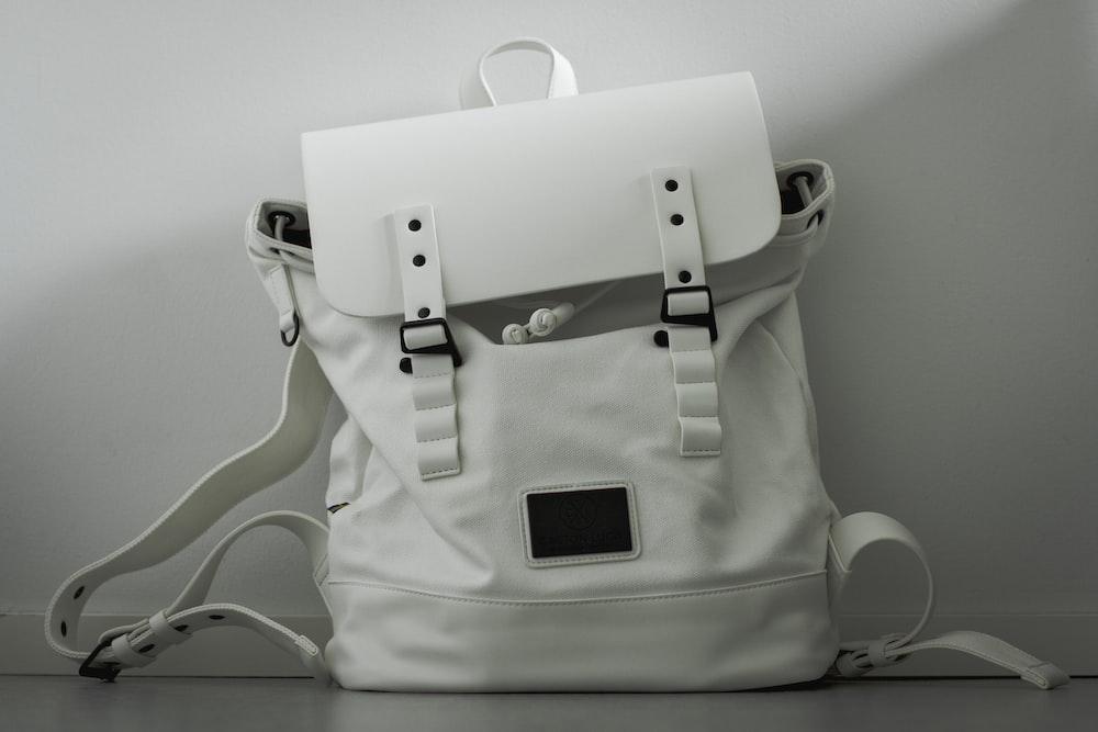 white and black leather handbag