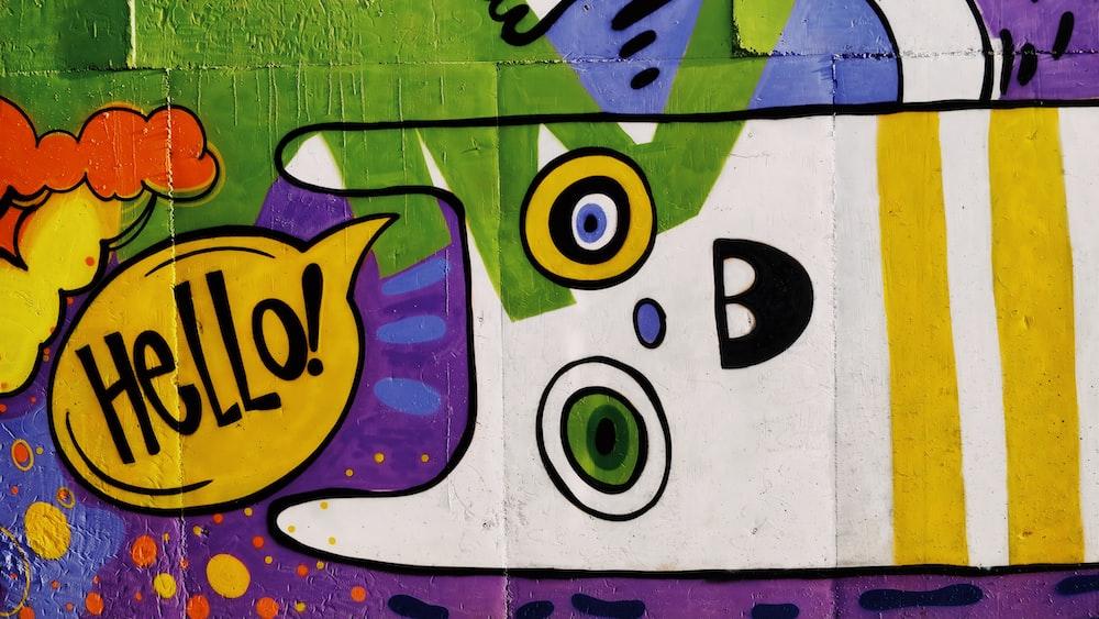 yellow and blue smiley graffiti