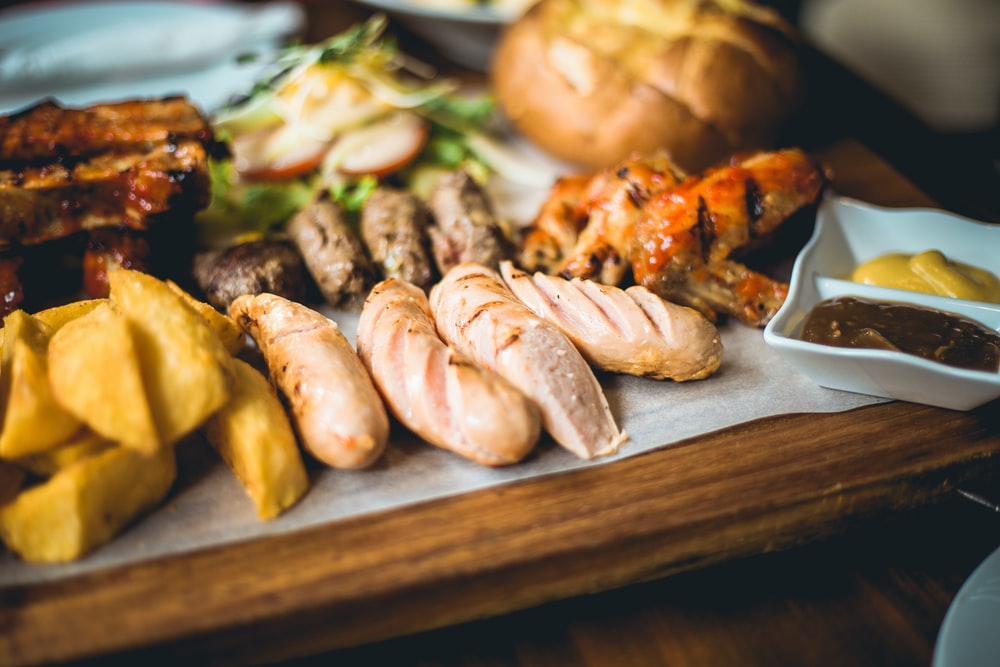 grilled sausage on brown wooden chopping board