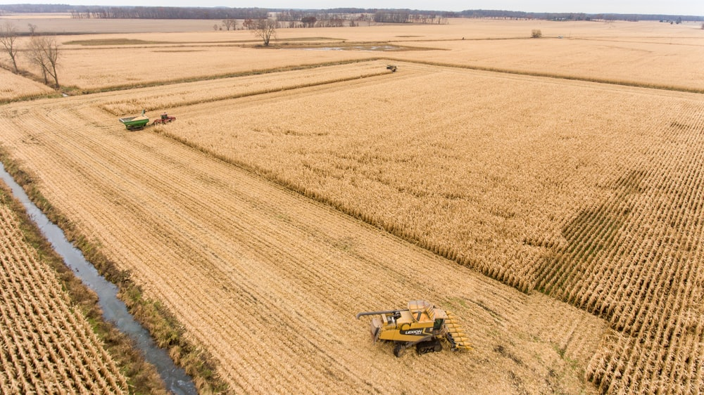 yellow and black heavy equipment on brown field during daytime