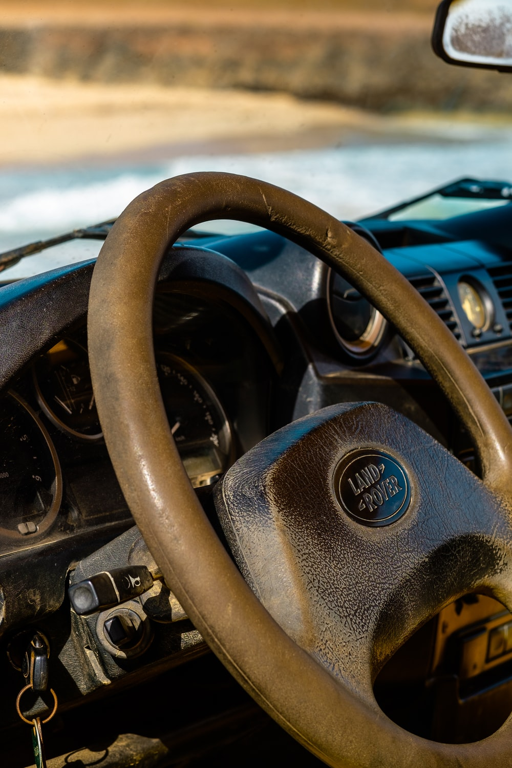 black and silver nissan steering wheel