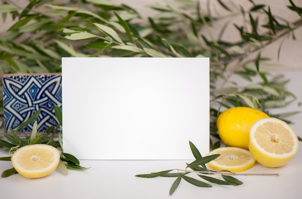 yellow lemon on white paper