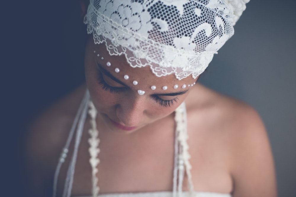 woman wearing white floral headband